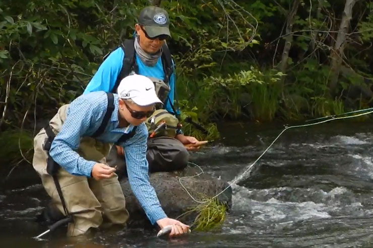 Guide Andrew Harris and guest release a trout