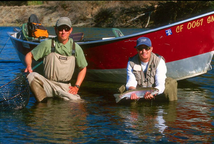 Guide Andrew Harris and guest with a Feather River steelhead