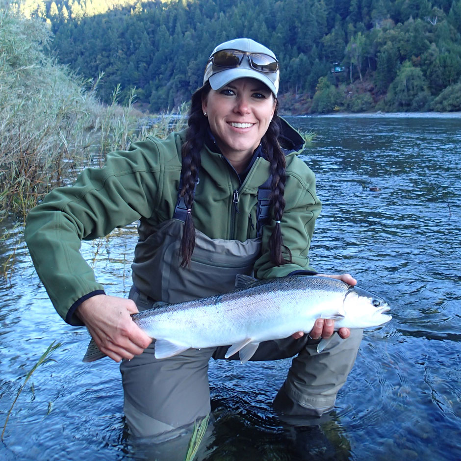 An angler with a chrome steelhead on the Lower Klamath River
