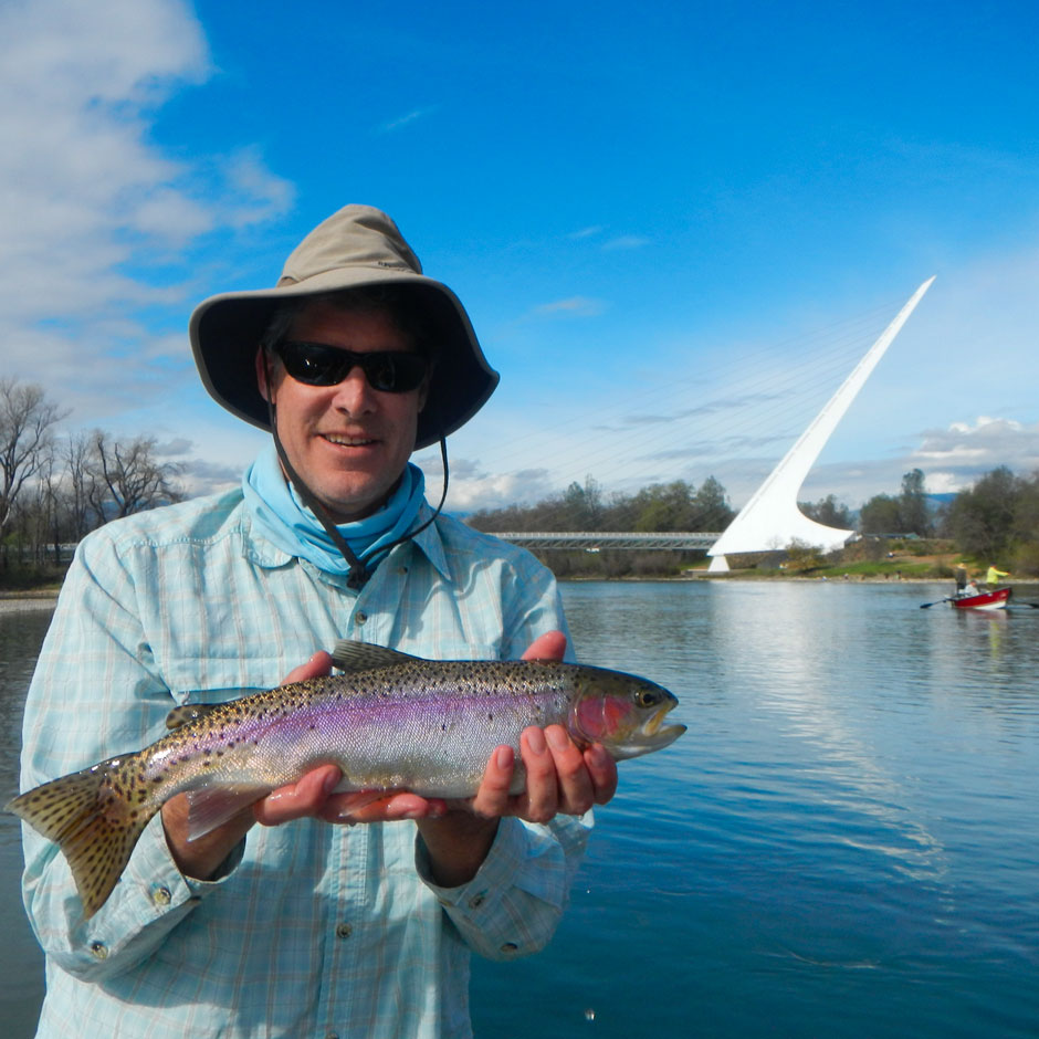 An angler with a wild trout caught near the Sundial Bridge