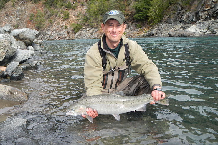 Guide Andrew Harris with a nice Smith River steelhead.